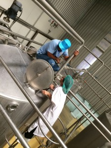 Ms. Napaporn Rattanametta climbs up a stock juice tank for checking effectiveness of Cleaning In Place system.