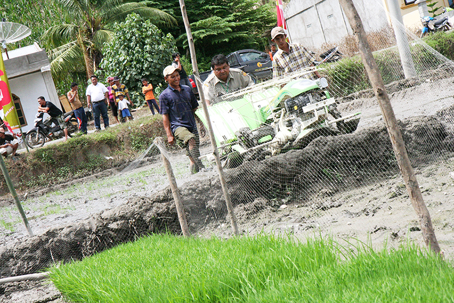 Mr. Elianor Sembiring tries a planting machine during its demonstration trial at Perbulan Village of Kabanjahe District of Indonesia.