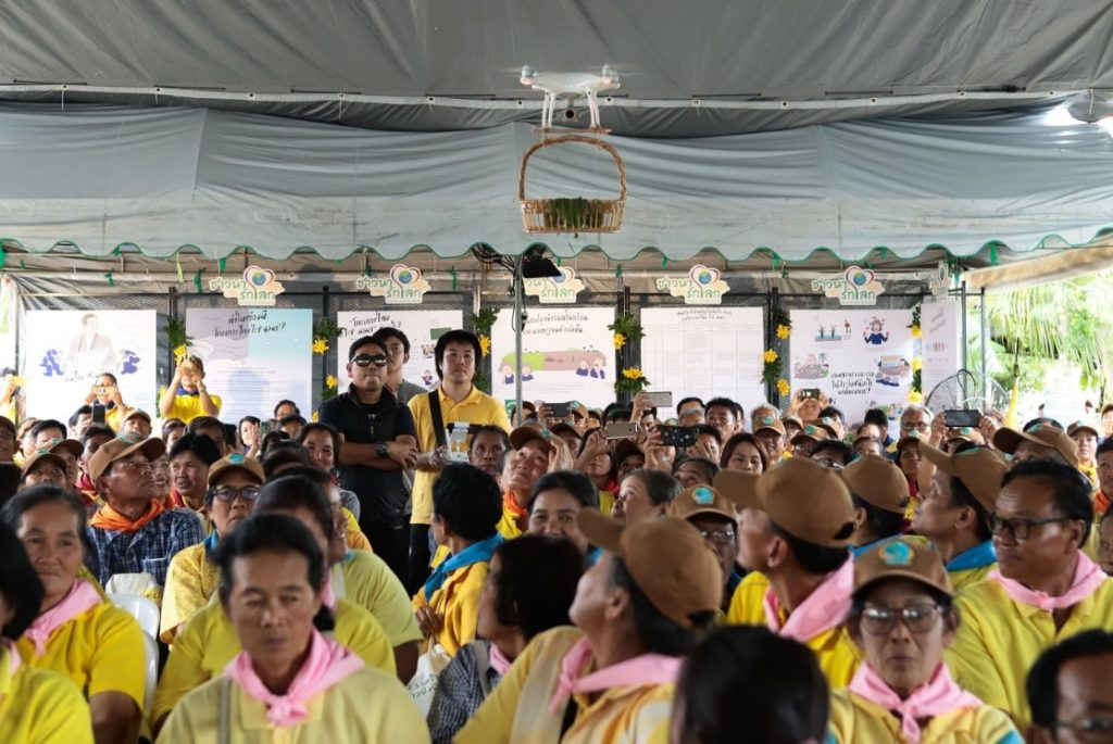Farmers look at the drone that carries rice seedlings during the opening ceremony. (Photo credit: GIZ Thailand)
