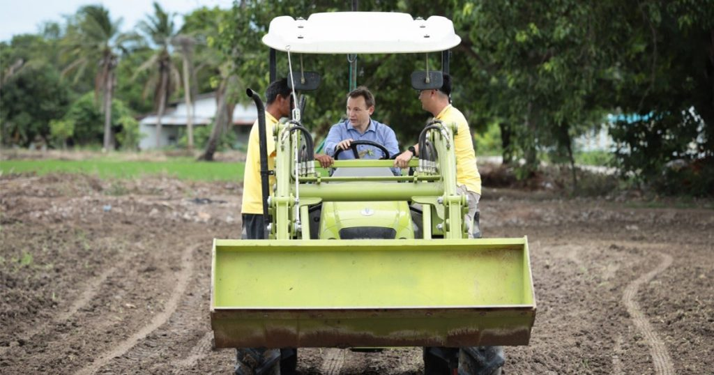 German Ambassador to Thailand Georg Schmidt drives a tractor in the rice field in Suphan Buri, Central Thailand. (Photo credit: GIZ Thailand)