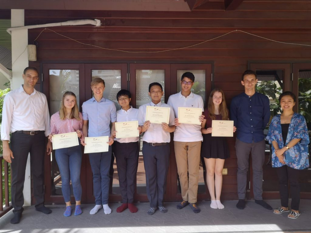 Matthias Bickel, the cluster's director hands over the certificates to the students from NIST for successfully completing their work experience week about sustainability in the rice supply chain. (Photo credit: Lisa Faust/GIZ Thailand)