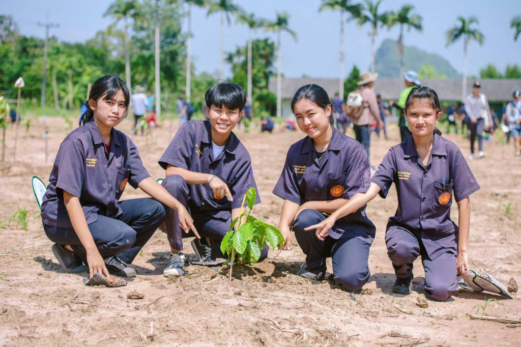 The students take a group photo at the recently-established demonstration plot inside the college. (Photo credit: GIZ Thailand)