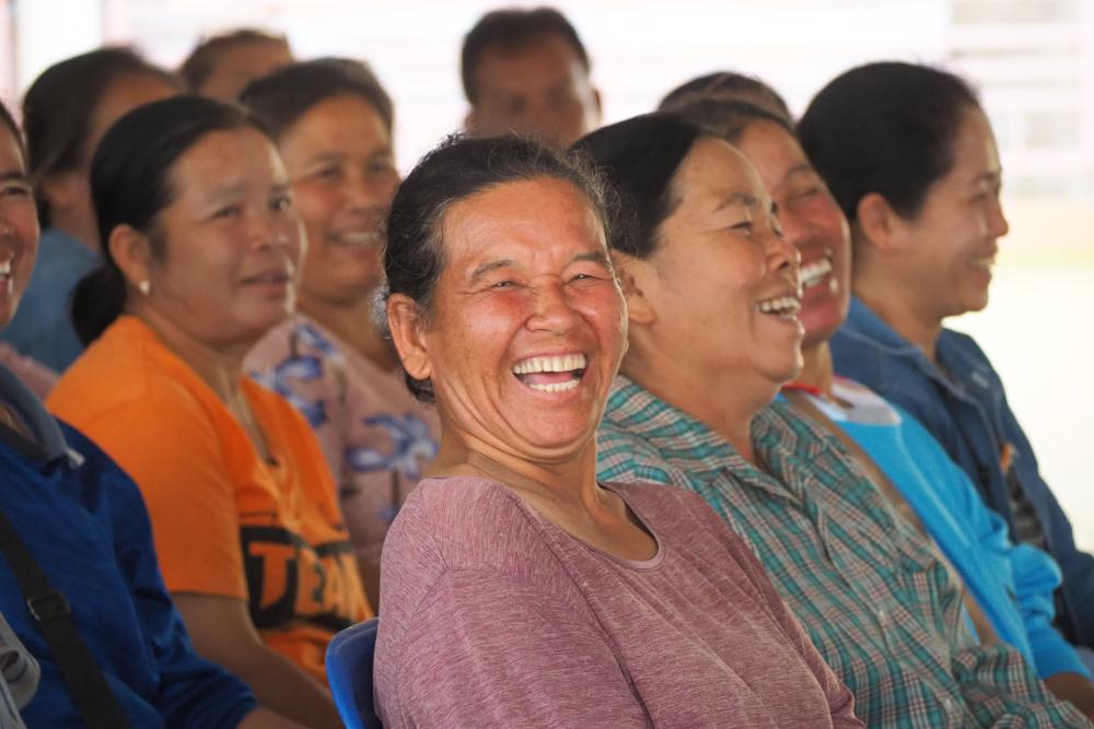 A lady farmer smiles to camera. (Photo credit: GIZ Thailand)